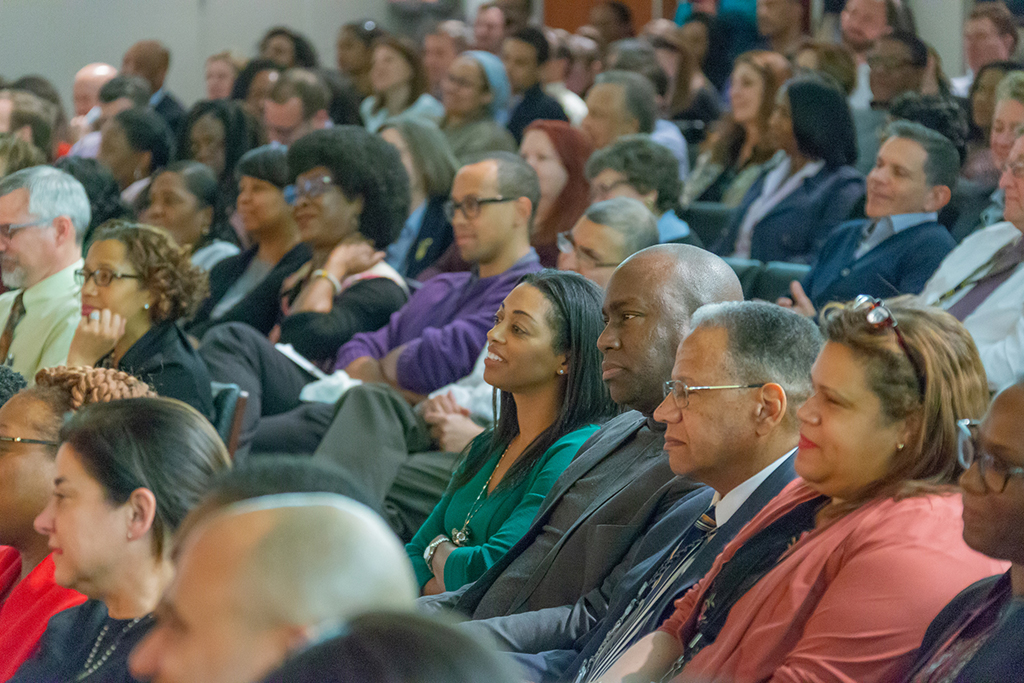 Staff at the SEC's headquarters in Washington, D.C. watch a presentation by Dr. Henry Louis Gates in honor of African American History Month.