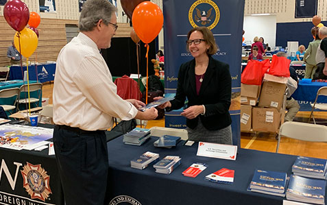 Cindy Hoekstra of the Philadelphia Regional Office speaks with an attendee at the 2019 Senior Citizen Expo