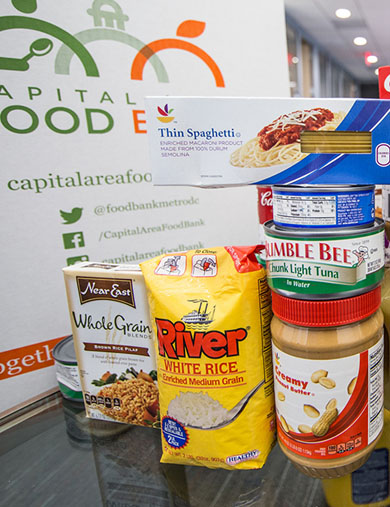 photo of nonperishable food items in front of a donation box
