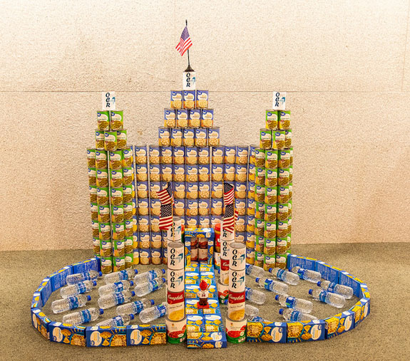 photo of cans stacked in the shape of a castle
