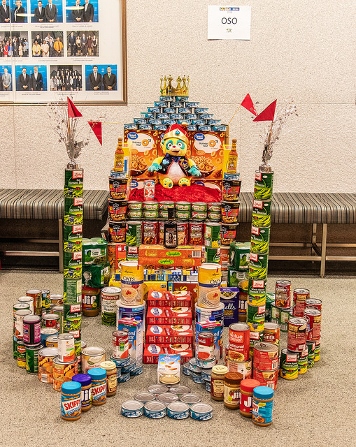 photo of cans stacked as a giant throne
