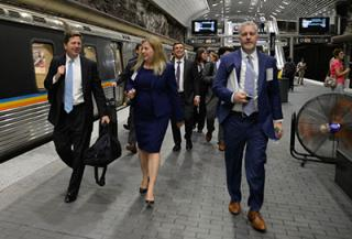 Commissioners walking through the ATL subway