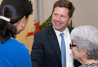 Chairman Jay Clayton talking to people
