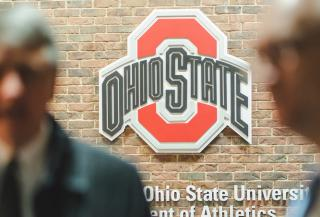 Image of attendees with the Ohio State logo in the background.