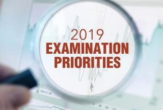 magnifying glass with the words 2019 Examination Priorities