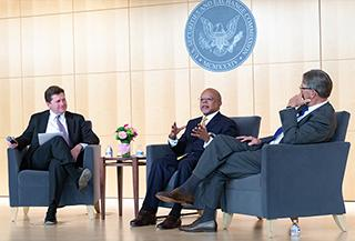 Chairman Clayton, Dr. Gates, and Glenn Hutchins answer questions during SEC event