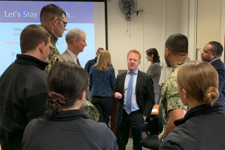 Enforcement Senior Counsel Jamie Davidson (center) talks with some attendees during the Chicago Regional Office's military outreach presentation at Naval Station Great Lakes, the Navy's largest training installation.
