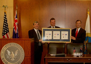ASIC Chairman Tony D'Aloisio, Senator Nick Sherry, and SEC Chairman Christopher Cox exhibit their mutual recognition agreement at a Washington D.C. news conference.