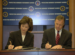 SEC Chairman Christopher Cox and U.S. Secretary of Labor Elaine L. Chao sign MOU