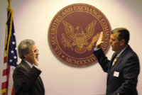 Luis Aguilar (left) is sworn in as SEC Commissioner